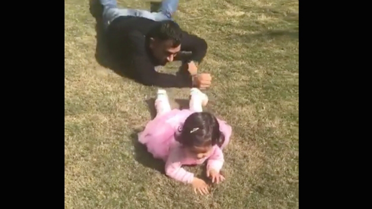 Dhoni PLAYING With Daughter Ziva