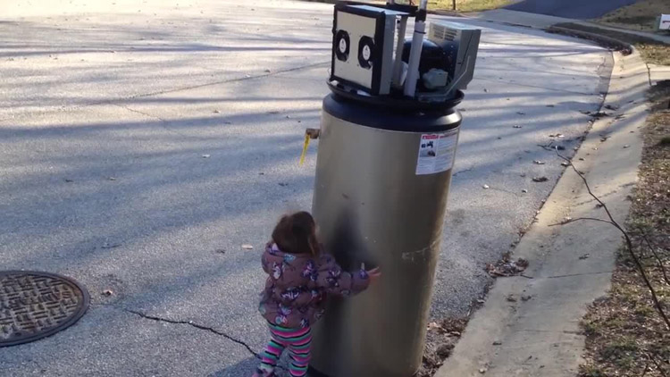 Adorable young girl mistakes water heater for robot