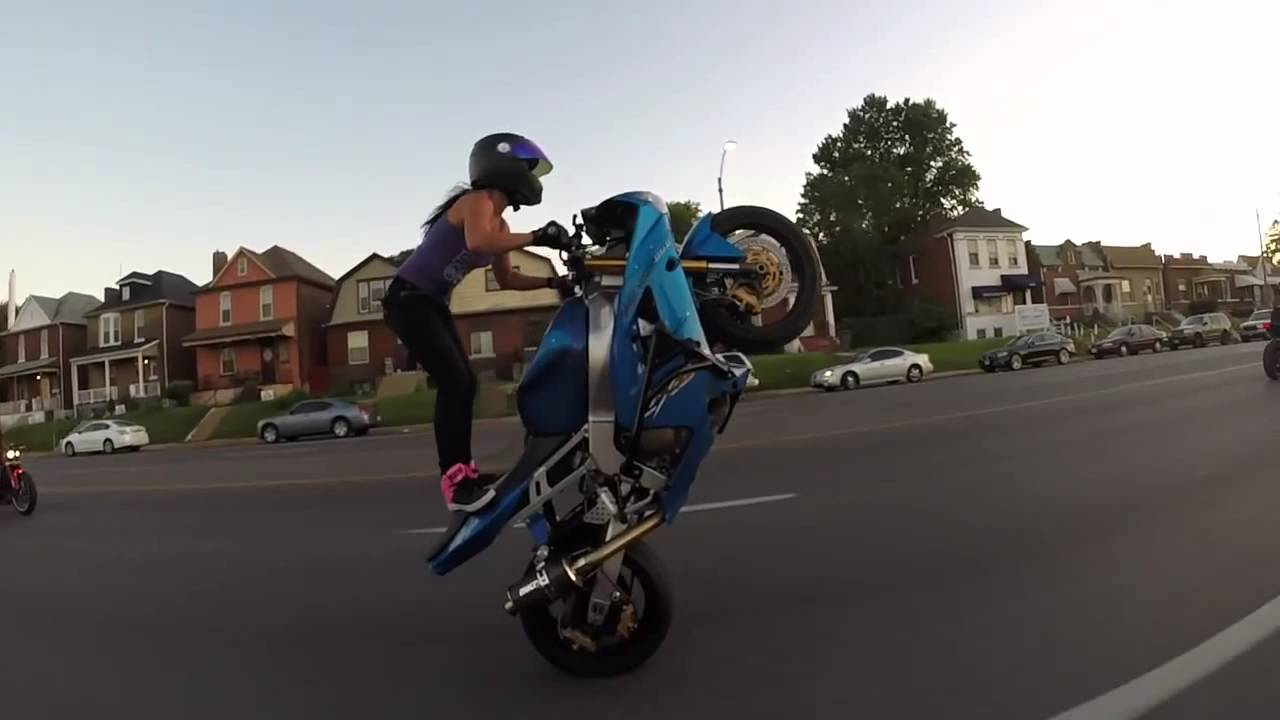 video of bike stunt by girl