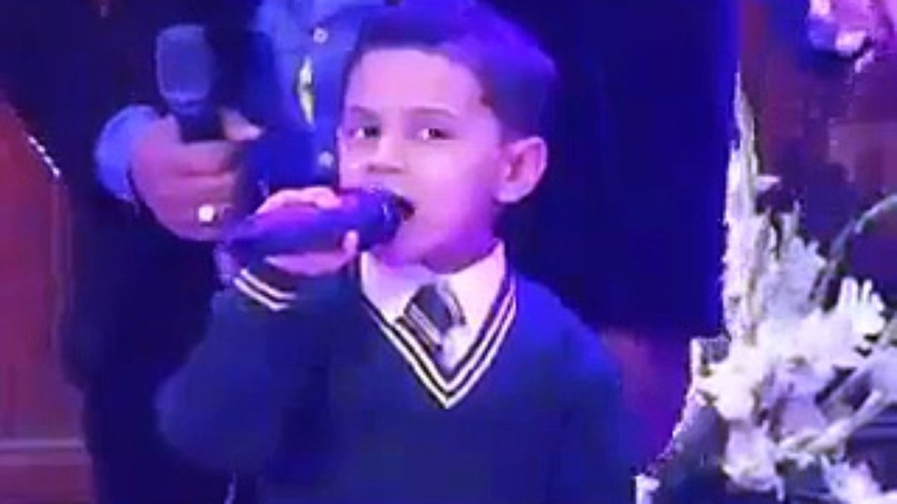 Small boy singing a song for his dad baba mere baba