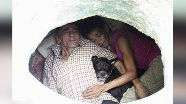 Homeless couple calls Colombian sewer home