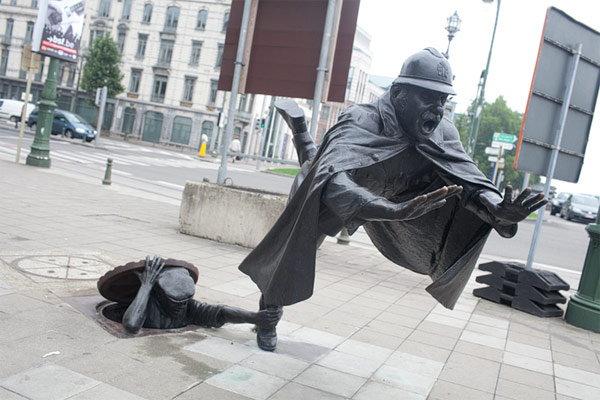 weird statue of the world
