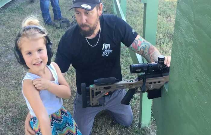 4 year old girl practices by Rifle
