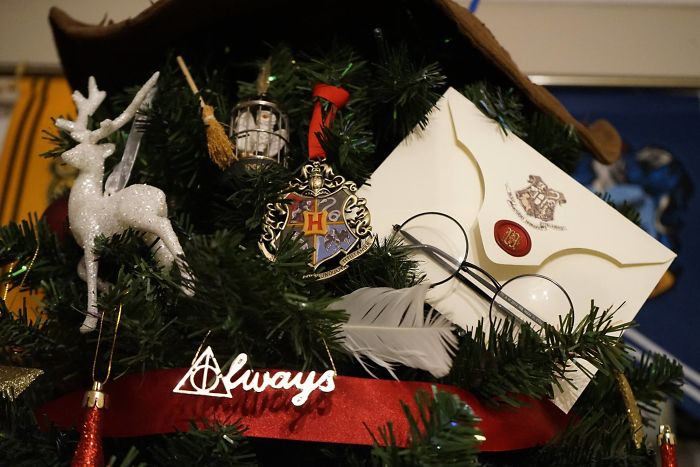 christmas tree decorating in england with Harry Potter ornaments and paraphernalia