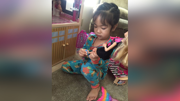 Little girl takes off her Barbies shoes to follow Asian tradition
