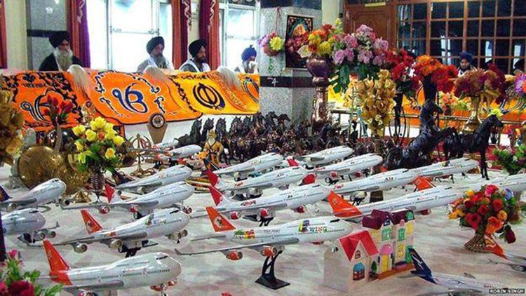Struggling to get a visa Offer a toy aeroplane at Shaheed Baba Nihal Singh gurdwara