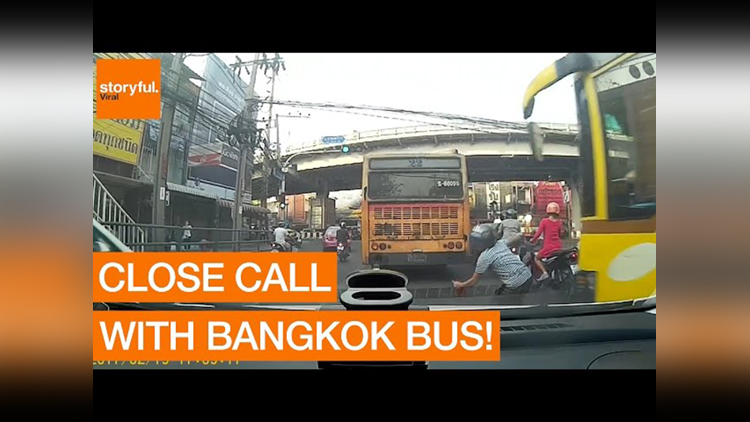 Bangkok Motorcyclists Have Close Call With Speeding Bus