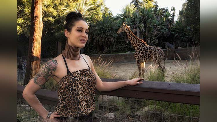 Giraffe woman gives up on her quest to have a long neck