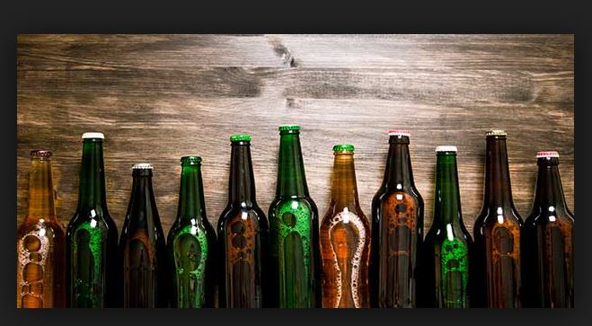 Why are beer bottles mostly green and brown in color