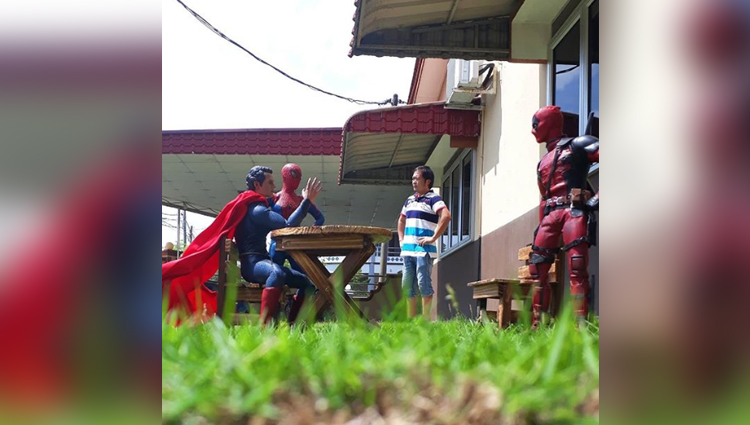 Man Clicks Pictures With Superhero Toys Using His Smartphone
