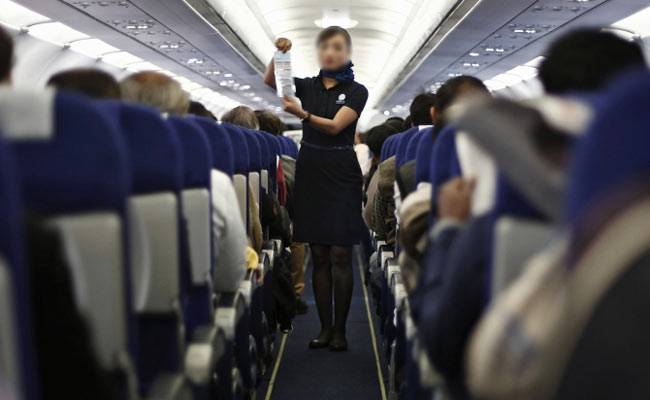 misbehave with the air hostess by passengers in flight