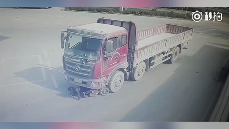 video woman miraculously survives after hit and dragged by a big truck