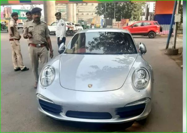 Ahmedabad Porche owner rides car without number plate was slapped with Rs 9 point 8 lakh fine