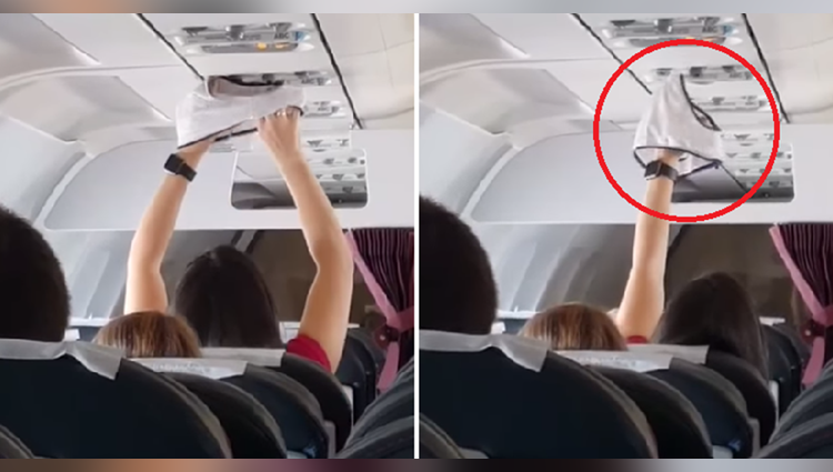 Woman dries underwear under air vent on-board a flight