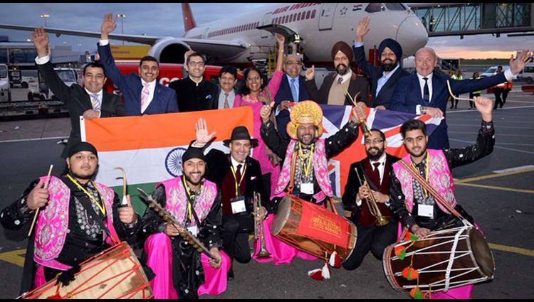 Dhol players see off passengers at Birmingham as Air India