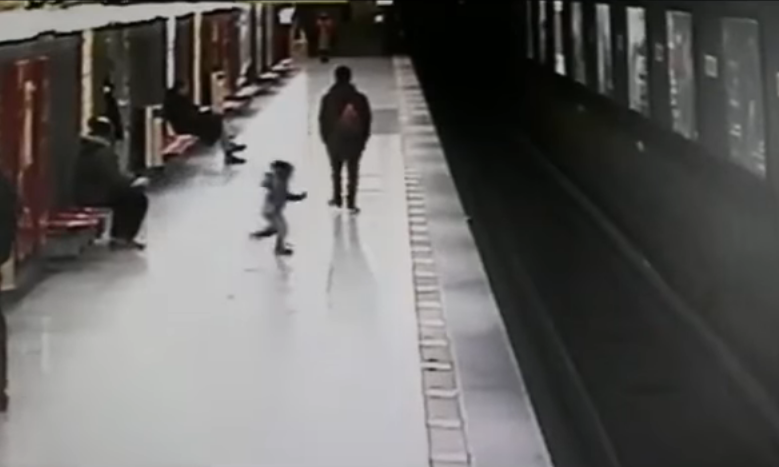 Toddler rescued from train tracks by quick-acting student