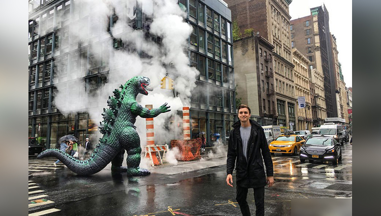 This traveler has a Godzilla as travel buddy