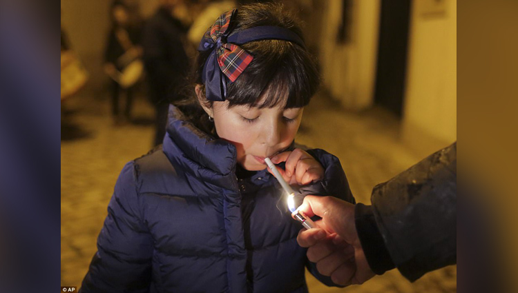 children smoke cigarettes in this village celebrates traditional epiphany