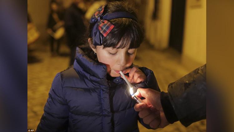 children smoke cigarettes in this village celebrates traditional epiphany