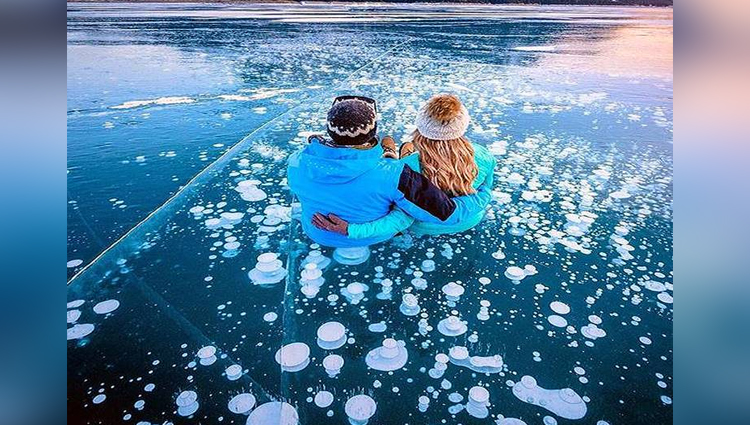 Stunning Bubbles Frozen Under Lake Abraham