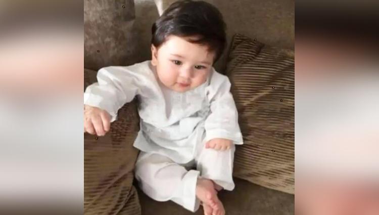 baby boy taimur ali khan looks every inch a nawab posing in a white kurta