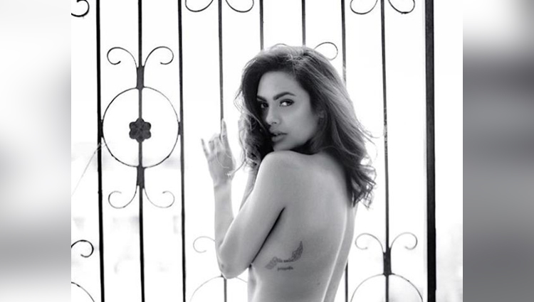 esha gupta flaunts her body tattoo in a topless pic