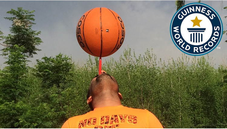 longest time spinning a basketball on a toothbrush - Guinness World Records