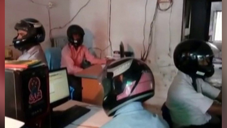 employees of bihar government office wear helmets at work