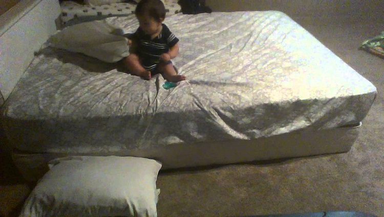 Baby stacks pillows on floor to escape from bed
