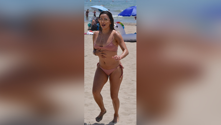 Eva Longoria looks like the ultimate in pink bikini