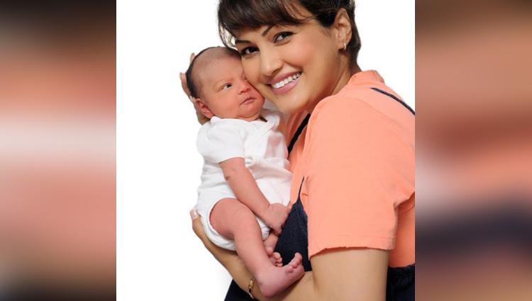 Nisha Rawal's BABY BOY sleeping in her arms