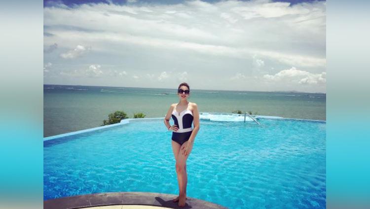 nithiba kaul seen in black swimsuit on the pool side