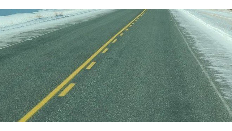 What is the reason roads have white and yellow markings
