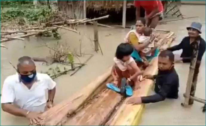 Assam MLA Gets Into Flood Water