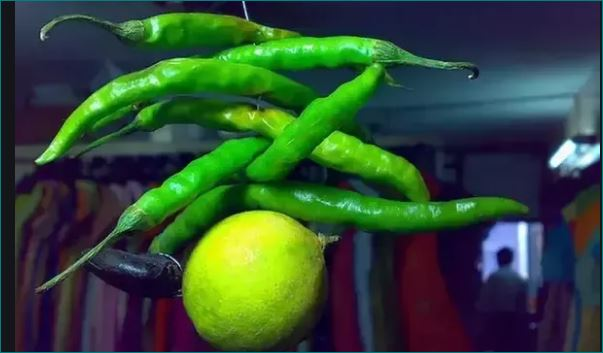 What is the significance in India of hanging lemon and chili