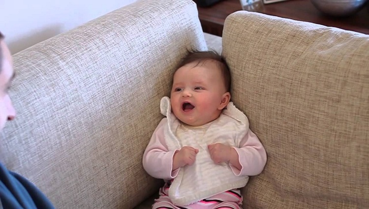 gorgeous baby girl trying to tell her daddy something very important