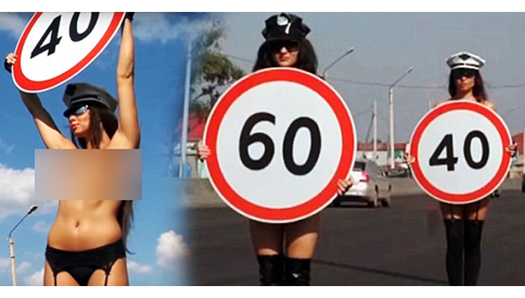 russia road safety campaign sees topless women carrying speed limit