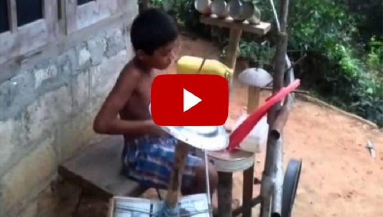 kid playing on homemade drum set
