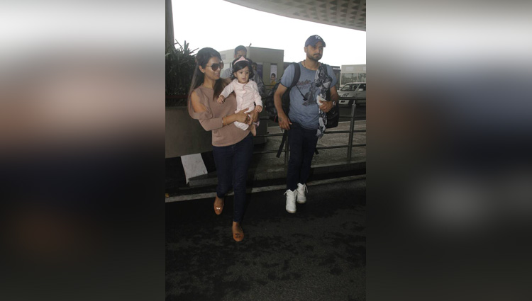 harbhajan singh and geeta basra at mumbai airport with daughter