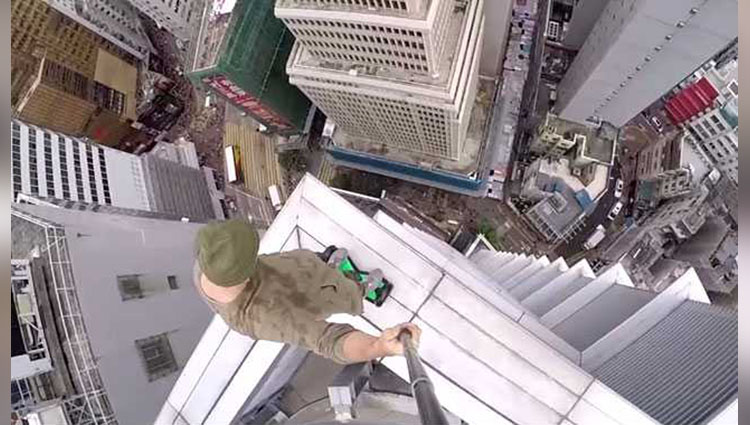 fearless dare devil rides hoverboard on edge of skyscraper 1