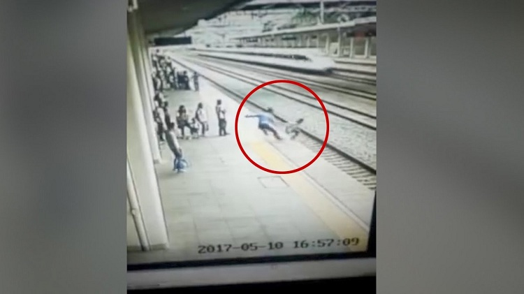 Footage Student saved from onrushing high-speed train