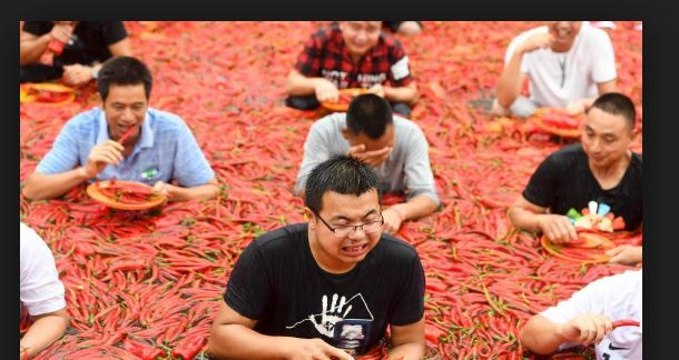 Chinese man eats 50 chili peppers in 68 seconds for a competition