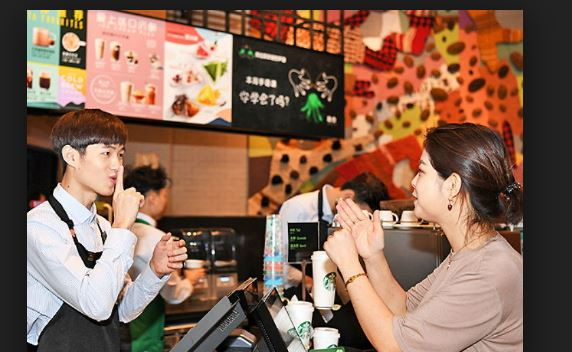 Starbucks opens silent cafe in China employs hearing impaired staff
