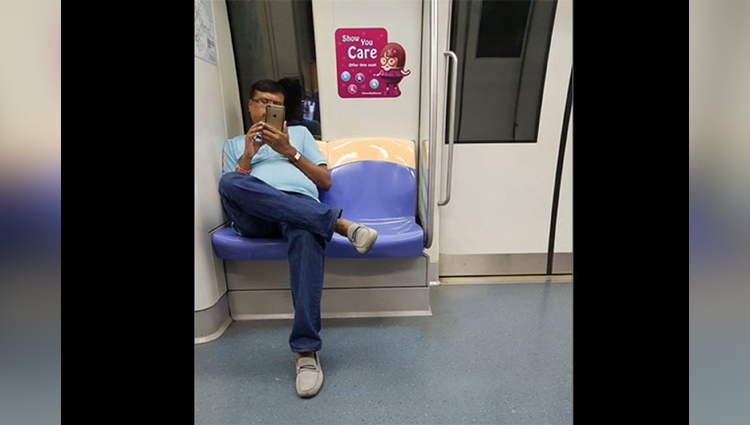 man making video of girl in metro