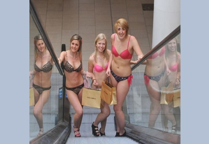 women in bikini at mall
