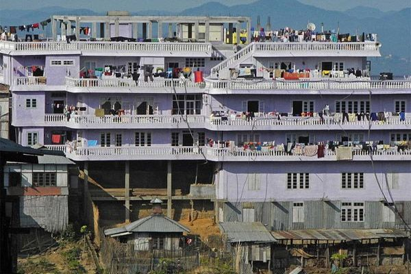 181 family members living in 100 rooms