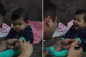 cut baby with her father