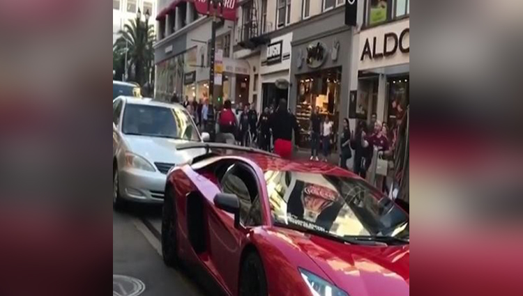 The Lamborghini car was parked in the market, then it was an accident