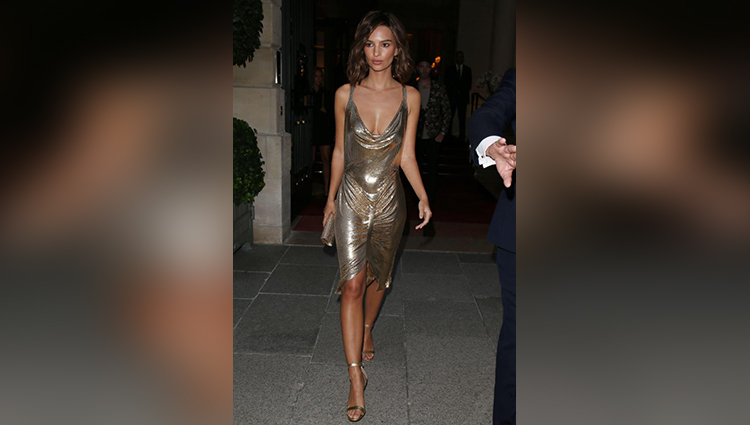 Golden girl: Emily Ratajkowski goes braless in a daring metallic dress at PFW