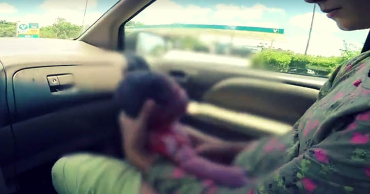 pregnant lady giving birth in car